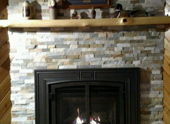 Valor Horizon Gas Fireplace - Sunset Gold Align Stone - Half Log Mantel Shelf - Raised Hearth